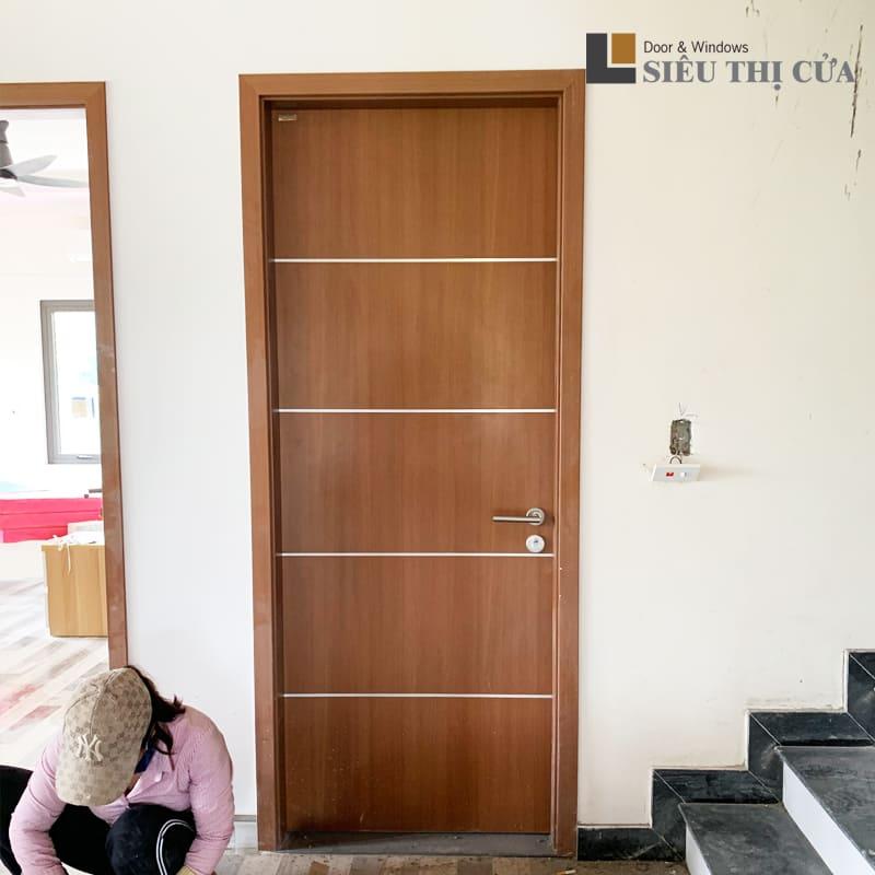 Cửa gỗ Huge mẫu chỉ nhôm LA204 của tập đoàn Austdoor